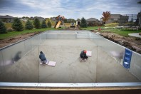 Adoneis Duchec, left, and Kevin Aguilar, right, smooth out cement in a pool designed by Combined Pool and Spa Friday, Oct. 13, in Sioux Falls. The pool is being installed at a home in the Timber Oak Estates development in southern Sioux Falls. Combined Pool and Spa workers have five more projects they are attempting to finish before the end of the year. Following an increase in high end home owners Combined Pool and Spa has noticed an uptick in business.