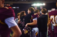 Madison students celebrate their 42-20 win against Dakota Valley Saturday, Nov. 11, at the DakotaDome in Vermillion.