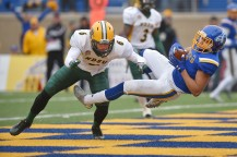 South Dakota State University's Jacob Brown catches the ball scoring a touchdown against North Dakota State University's James Hendricks during the game Saturday, Nov.4, at Dana Dykhouse Stadium in Brookings.