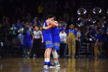 SDSU's Ellie Thompson and Macy Miller hug when the buzzard goes off after their win against USD Tuesday, March 6, during the Summit League basketball tournament at the Denny Sanford Premier Center in Sioux Falls.