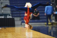 Champion Legacy dancer Ashtyn Larson performs at half time in the Lincoln vs Washington game Thursday, March 15, at the Sioux Falls Arena.