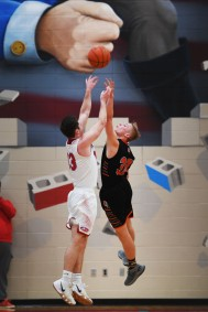 Lincoln's Jared Jaros takes a shot against Washington's Gabe Person during the game Thursday, Jan. 24, at Lincoln.