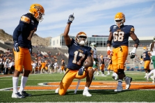 "UTEP's Justin Garrett scores a touchdown during the game against Charlotte Saturday, Nov. 9, at the Sun Bowl in El Paso. Garrett had a message under his eyes that reads ""RIP sister."""