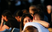 Horizon High School holds a vigil for Javier Rodriguez Monday, Aug. 5, at the high school football field. Rodriguez is a former student who was killed Saturday while shopping with his uncle at Walmart. He just started his sophomore year at Horizon.