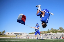 Americas' Evan Chisolm does a back flip before the team takes the field for the game against Coronado Friday, Nov. 1, at the SISD Student Activities Center in El Paso.