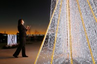 Serina Wooten, kiosk agent for American Airlines, looks at the DŽcor IQ tree that was donated to El Paso in remembrance of the Walmart shooting victims Tuesday, Dec. 10, at the airport in El Paso. The lighted tree has 22 panels in honor of the people who lost their lives on Aug. 3 when a gunman opened fire inside Walmart. The tree will be on display till Jan. 7, 2020.