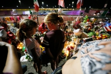 Evy Scout Houghton, left, and Finley Houghton, right, talk to each other while looking at the vigil outside Walmart Tuesday, Aug. 6, in El Paso. Evy and Finley's dad, an El Paso native, said they don't understand what is going on but they are afraid they are going to get shot going outside after the shootings at Walmart Saturday, Aug. 3.